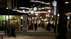 People walking through a pedestrian zone at Christmas time Stock Footage