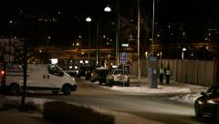 Cars and pedestrians on a winter night in town Stock Footage