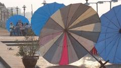 Street restaurant parasols at the Mekong,Nong Khai,Thailand Stock Footage