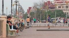Lady does the hula hoop at the Mekong,Nong Khai,Thailand Stock Footage