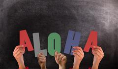 Composite image of hands holding up aloha Stock Illustration