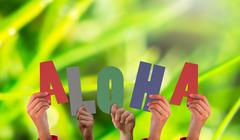 Stock Illustration of Composite image of hands holding up aloha