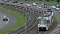 City Train with Freeway Traffic 2 Stock Footage