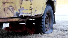 Rusty vehicle with flat tire on grass Stock Footage