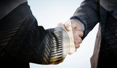 Composite image of business people shaking hands close up Stock Illustration