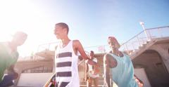 Happy skateboarder friends of African descent hanging out Stock Footage