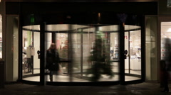 Revolving door to a store at Christmas time lapse Stock Footage