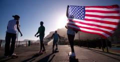 Teenage African American skateboarders waving an American flag Stock Footage