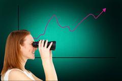 Composite image of charismatic businesswoman predicting future success - stock photo
