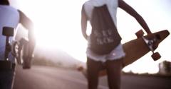 Longboarder legs walking together in slow motion Stock Footage