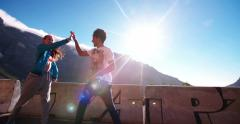 Flexible teenagers stretching and high five for outdoor sports - stock footage