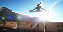 Flexible acrobatic breakdancer jumping and doing the splits Stock Footage