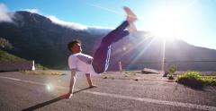 Multi-ethnic breakdancer balancing performing a hand stand Stock Footage