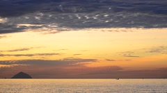 Lonely fisherman boat drifting in the ocean at sunrise Stock Footage