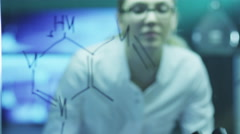 Woman Scientist is Drawing Organic Chemical Formulas on Glass Stock Footage