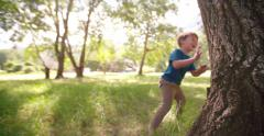 Little boy playing hide and seek - stock footage