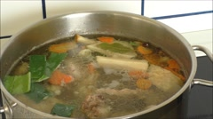 Traditional way of cooking chicken soup in big pot Stock Footage
