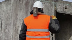 Worker with sledge hammer against the wall Stock Footage