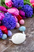 easter eggs with tulips and hyacinth - stock photo