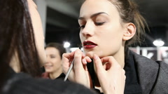 Professional Make-up artist doing model make up in backstage Stock Footage