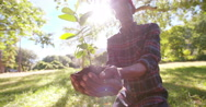 Stock Video Footage of Soil and sunlight for a new Spring tree
