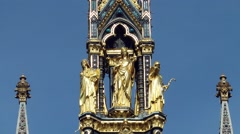 Albert memorial three gold statues close up deep blue sky London Stock Footage
