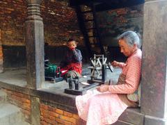 Weaving Ladies in Nepal - stock photo