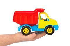 Toy car truck in hand Kuvituskuvat