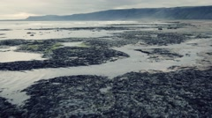 Aerial view of empty Iceland beach with dramatic clouds in background. Stock Footage