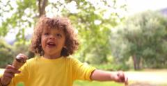 Happy African American boy having an ice cream in the park Stock Footage