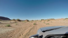 Driving in the desert with a 4wd car - stock footage