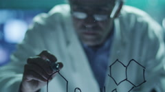 Scientist is Drawing Organic Chemical Formulas on Glass Stock Footage