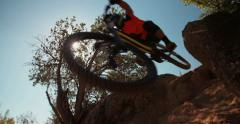 Adventurous mountain biker going over rocks on an off-road trail Stock Footage