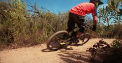 Mountain biker in the moutains doing a cross country trail Stock Footage