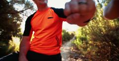 Two mountain biker fist bumping Stock Footage