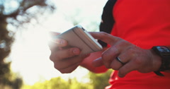 Mountain biker holding a smart phone with tracking app Stock Footage