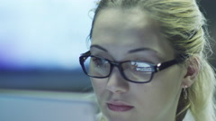 Stock Video Footage of Woman is Using Tablet and Have Reflections of Screen in Glasses