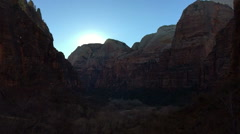 SlowMo Canyon Sunset Pan at Zion Weeping Rock (1280x720 29.97 FPS) - stock footage