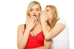 Gossip rumour woman telling secrets to your girlfriend - stock photo