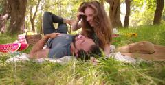 Girl feeding her boyfriend chocolate in a park Stock Footage