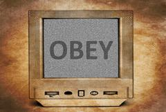 Obey sign on vintage TV - stock photo
