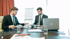 Handsome young businessmen at work - stock footage