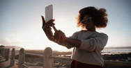 Stock Video Footage of African American hipster teen girl at beach taking selfie on phone