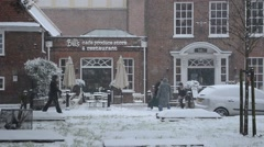 Clearing snow in England Stock Footage