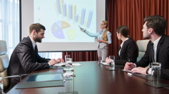Business woman making a presentation - stock footage