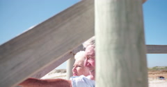 Senior adult retired couple at the beach - stock footage