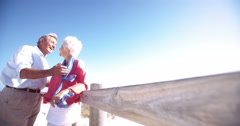 Loving retired senior couple together at the beach - stock footage
