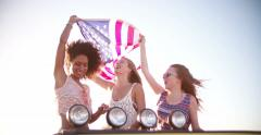 Stock Video Footage of Afro girl flying an American flag with friends