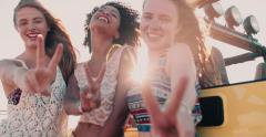 Happy Afro girl and friends smiling showing peace sign - stock footage