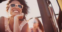 Afro girl and her friend on a road trip - stock footage